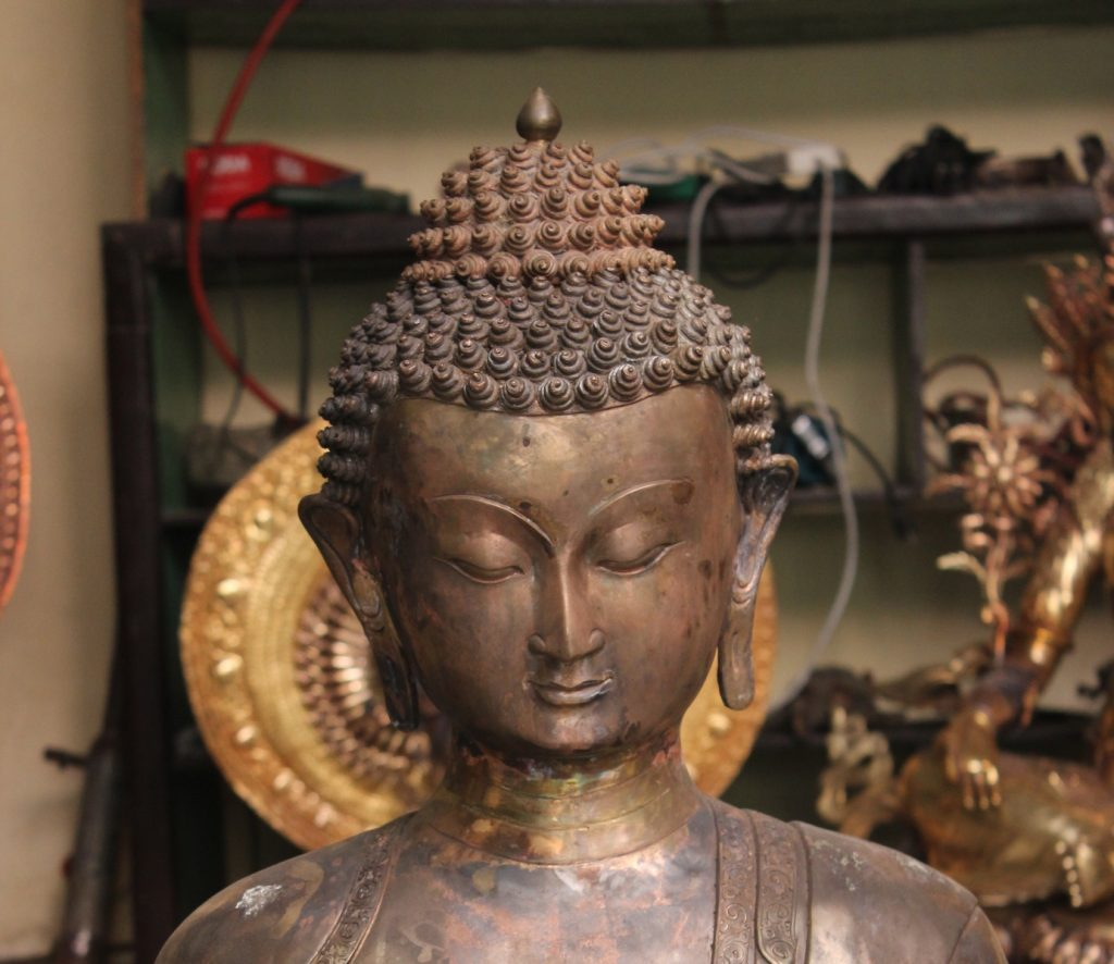 Sculpting Buddha Face Carvings