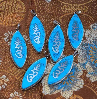 Bundle of 6 Tibetan om mantra pendants