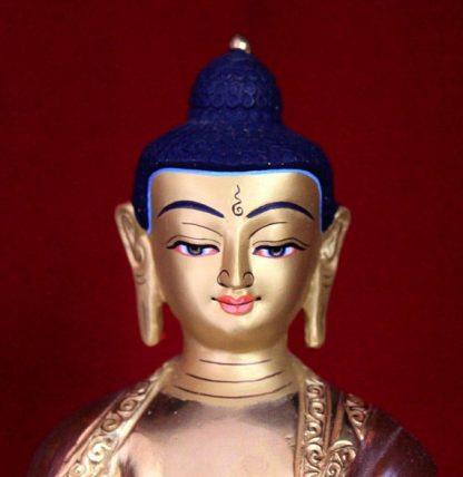 shakyamuni buddha statue gold painted face