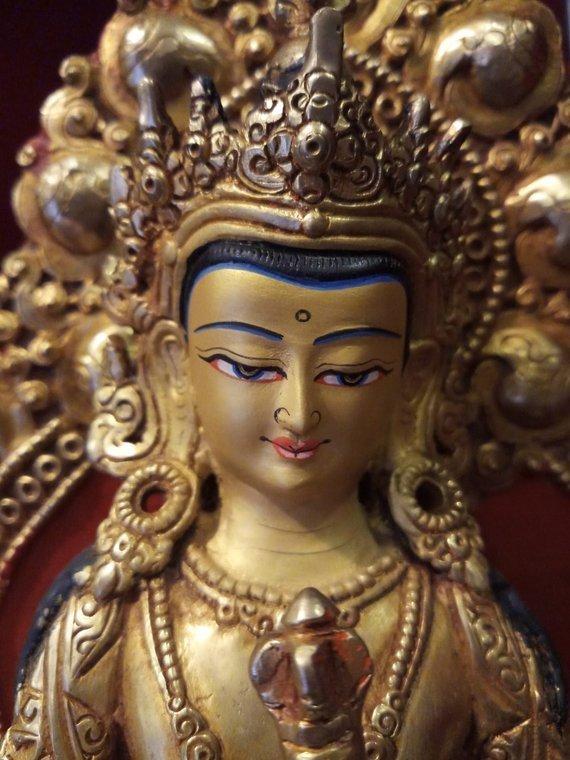 vajrasattva gold statue face