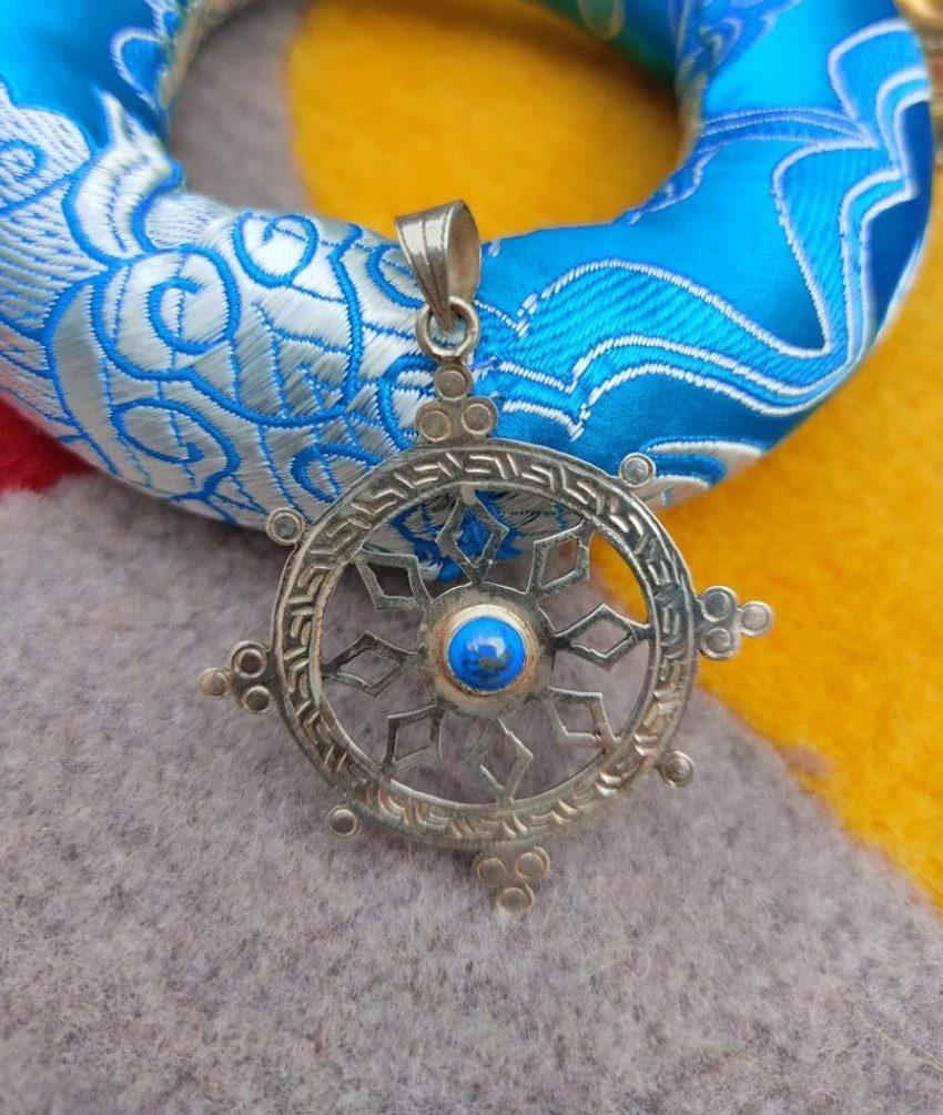 Dharma Chakra Pendant presents